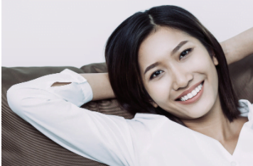 A woman is happy after teeth whitening in Chelsea MA.